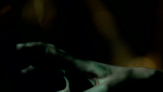 Dirty zombie hand, victim reaching out the murderer, asking for mercy, closeup video