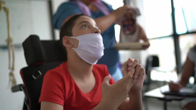 Disability student at school - wearing face mask video