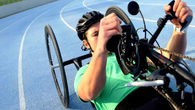 Disabled athlete racing in wheelchair 4k video