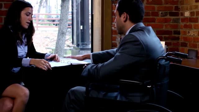 Disabled Businessman Discusses Report -  Multi CU video