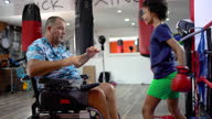 istock Disabled coach is preparing teen girl to kick boxing match 1279383032