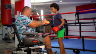 istock Disabled coach is preparing teen girl to kick boxing match 1279383795