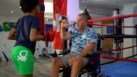 istock Disabled coach is preparing teen girl to kick boxing match 1279385615