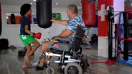 istock Disabled coach is preparing teen girl to kick boxing match 1279386462