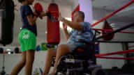istock Disabled coach is preparing teen girl to kick boxing match 1279386649