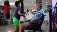 istock Disabled coach is preparing teen girl to kick boxing match 1279387771