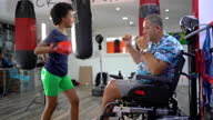 istock Disabled coach is preparing teen girl to kick boxing match 1279388529