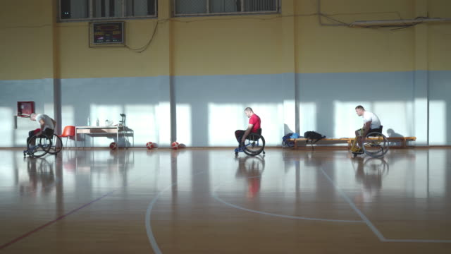 Disabled men playing basketball in the wheelchair