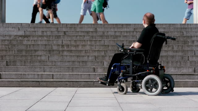 disabled person in a wheelchair social exclusion video