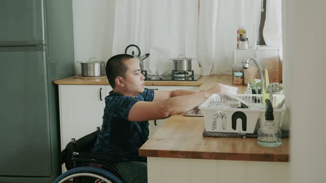 Disabled person washing a cup - Stock Video Disabled person washing a cup after drink water. independence stock videos & royalty-free footage