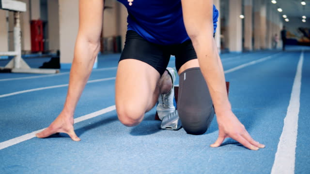 Disabled runner stands on a start, prosthetic leg. Disabled runner stands on a start, prosthetic leg. 4K orthopedic equipment stock videos & royalty-free footage