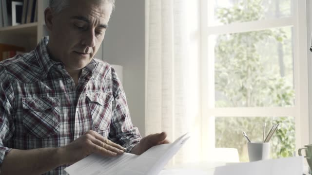 Disappointed man checking his home finances