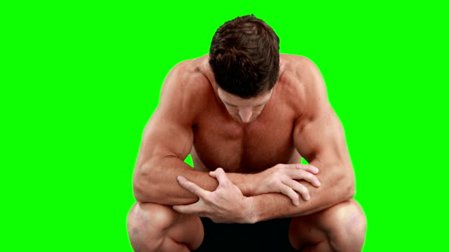 Disappointed muscular man looking down video