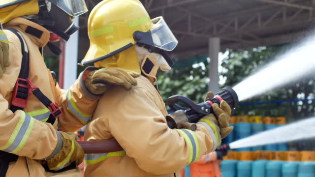 lampang, thailand - 18 july2018. disaster training exercise depicting gas station in lampang, thailand - firefighter stock videos and b-roll footage