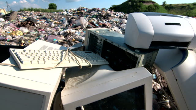 Discarded obsolete computer scrap at rubbish dump Discarded obsolete computer scrap at illegal rubbish dump tracking shot electrical equipment stock videos & royalty-free footage