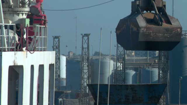 Discharging Grain Cargo With Ship's Grab Tele shot of a ship's grab discharging grain into hopper unloading stock videos & royalty-free footage