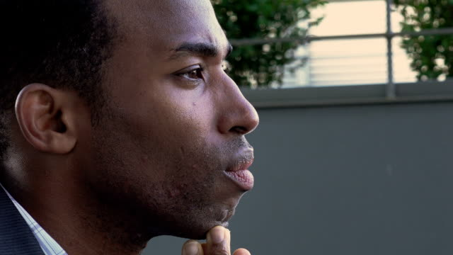 discomforted black businessman sitting alone deep in his problems: failure video
