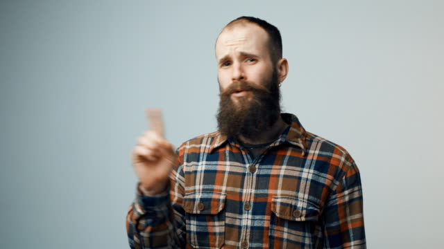 discontent bearded hipster man denying - proibizione video stock e b–roll