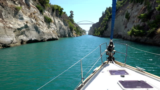 Discovering Greece - Corinth canal Sailboat passing through the Corinth Canal at sunny day on Peloponnese in Greece greek islands stock videos & royalty-free footage