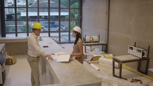 Discuss work in construction site The Professional engineer Checking work. Professional engineer Checking work on the construction site, Engineer wearing protective clothing and helmet. vintage architecture stock videos & royalty-free footage