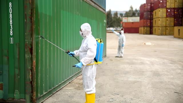 Disease control service Staff Disinfect Cargo To Prevent Spread COVID-19