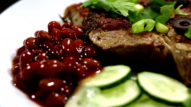 A dish of steak, beans and vegetables video