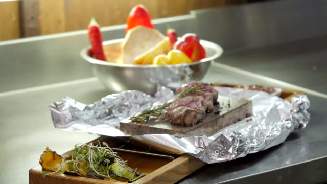 a dish with meat on the cook's table - aluminum foil stock videos & royalty-free footage