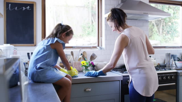 Dishes is one of the things we enjoying doing together 4k video footage of a young girl helping her mother with the dishes at home washing dishes stock videos & royalty-free footage