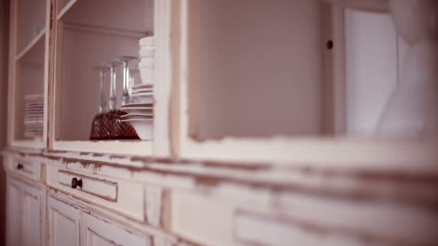 Dishware in kitchen cupboard video