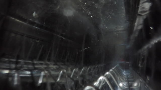 Dishwasher running, view from top rack Top Rack of dishwasher as it runs a cycle dishwasher stock videos & royalty-free footage