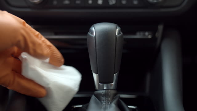 disinfecting vehicle interior to prevent the spread of covid-19 - igiene video stock e b–roll
