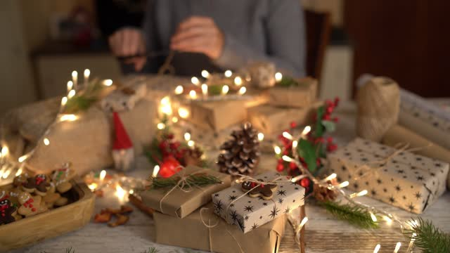 A display of Christmas gifts and lights on a table top