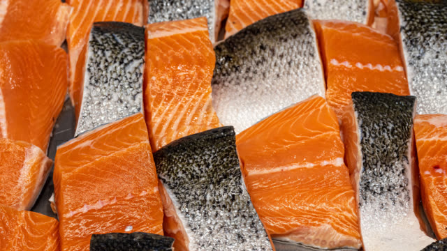 display of fresh salmon fillets - trout video stock e b–roll