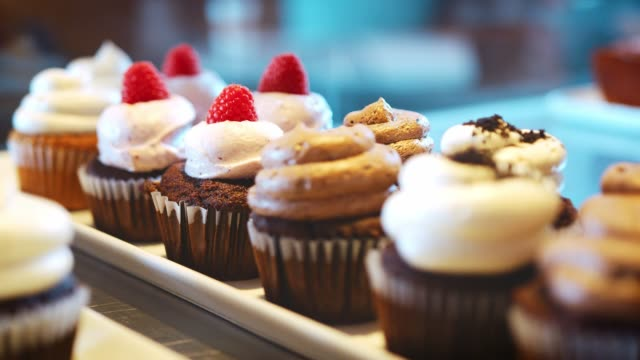 display of grain free cupcakes in coffee shop - desserts stock videos and b-roll footage