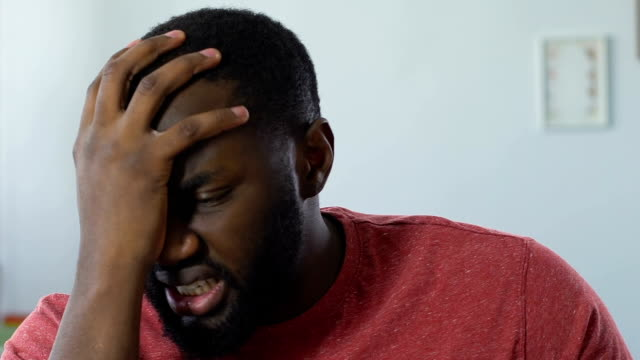 Displeased African American Man Watching Game On Tv Disappointed With  Result Stock Video - Download Video Clip Now - iStock