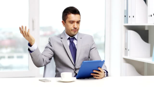 displeased businessman with tablet pc computer and coffee at office business, education, people and technology concept - displeased businessman with tablet pc computer and coffee at office angry stock videos & royalty-free footage