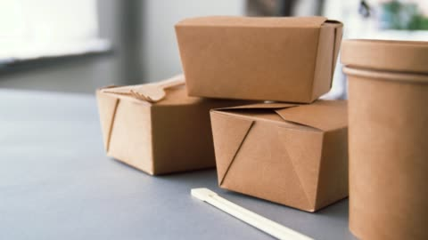 disposable paper containers for takeaway food package, recycling and eating concept - disposable paper containers for takeaway food on table container stock videos & royalty-free footage