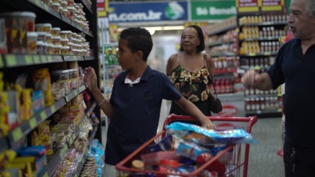 Dispute in shop Family on Supermarket snack aisle stock videos & royalty-free footage