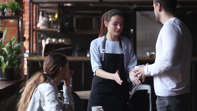 dissatisfied couple restaurant clients complaining about cold coffee bad service - rabbia emozione negativa video stock e b–roll