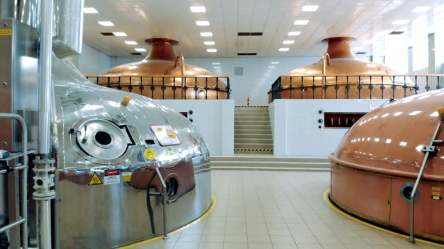 Distillery facility with various reservoirs Distillery facility with various reservoirs. 4K lager stock videos & royalty-free footage