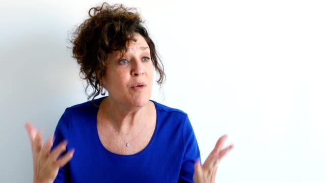 distressed bullied mature caucasian female defending herself 4k - wine filmów i materiałów b-roll