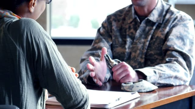 Distressed military veteran talks with psychiatrist video