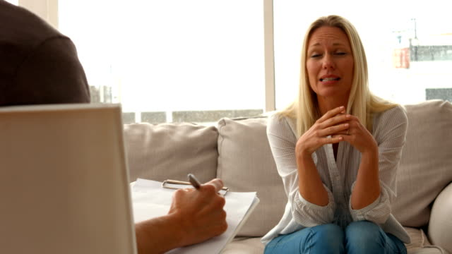Distressed woman talking to therapist video