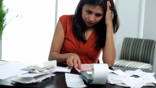 Distressed woman working on personal finances video