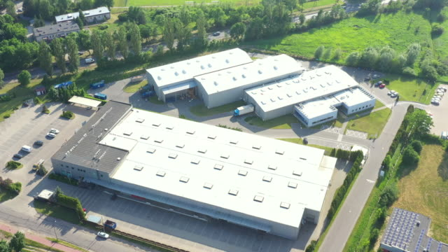 Distribution warehouse with trucks of different capacity. Aerial View
