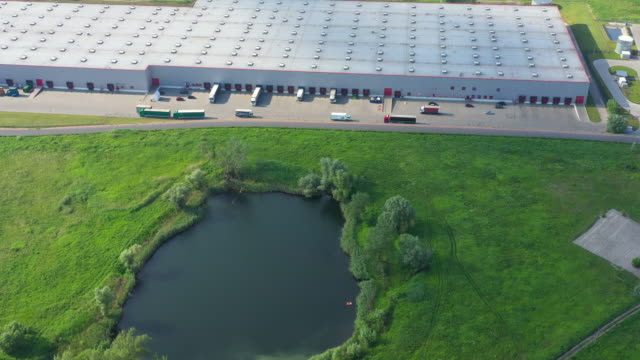 Distribution warehouse with trucks of different capacity. Aerial View Distribution warehouse with trucks of different capacity. Aerial View warehouse aerial stock videos & royalty-free footage