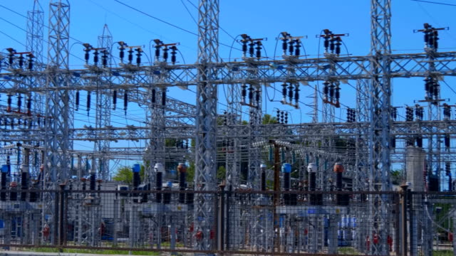 distributive electrical substation with a huge amount of equipment - sottostazione elettrica video stock e b–roll