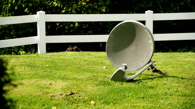 Ditching Unwanted Satellite Dish Discarding an unwanted satellite television dish. crockery stock videos & royalty-free footage