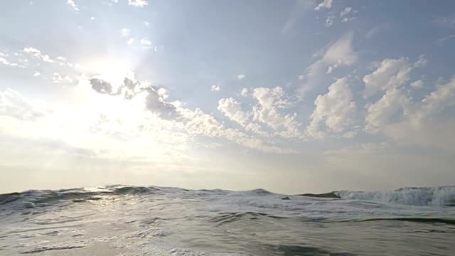 Dive in and out sea water video