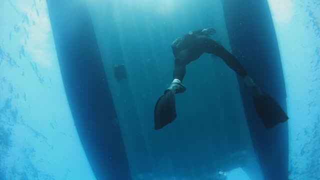 HD SLOW MOTION: Diver Swimming Back to Boat video
